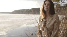 Girl is having a walk near the lake. Charming girl is having a walk near the lake in the forest stock video
