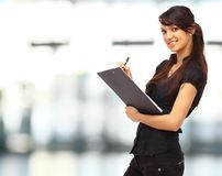 Charming girl holding a folder Royalty Free Stock Image
