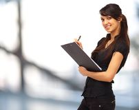 Charming girl holding a folder Royalty Free Stock Photography