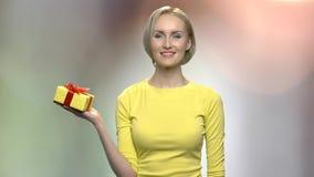 Charming girl holding gift box. stock video