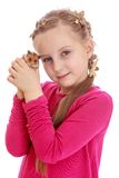 Charming girl holding a hamster in his fist Stock Images