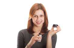 Charming girl holding a perfume Royalty Free Stock Images