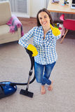 Charming girl holding vacuum cleaner and showing clearness of ca Royalty Free Stock Photos