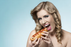 Charming girl with hot-dog Royalty Free Stock Image