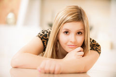 Charming girl lies on floor Stock Images