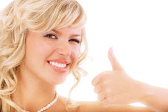 Charming girl lifts upwards thumb Royalty Free Stock Photo