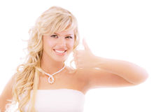 Charming girl lifts upwards thumb Royalty Free Stock Photography
