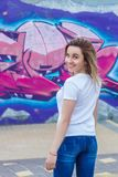A charming girl looks over her shoulder in the street royalty free stock images