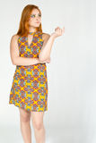 Charming girl looks to the side. Redheaded girl wearing colorful Royalty Free Stock Photos