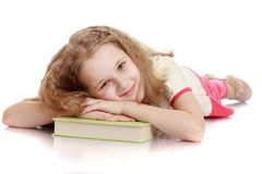 Charming girl lying on the floor Royalty Free Stock Images