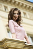 Charming girl near antique building Stock Photography
