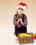 Charming girl in a New Year's cap Stock Image
