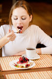 Charming girl and pie slice. Royalty Free Stock Photography