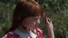 Charming girl posing in sunlight stock footage