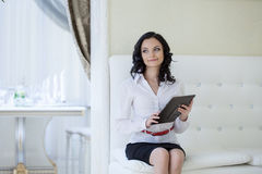 Charming girl posing with tablet PC in hotel room Stock Photos