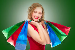 Charming girl with purchases Royalty Free Stock Photo