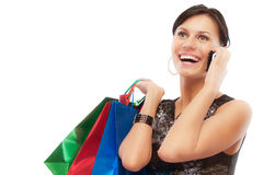 Charming girl with purchases speaks by phone Stock Photo