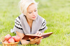 Charming girl reads book. Stock Photo