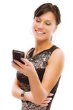 Charming girl reads sms on phone Stock Images