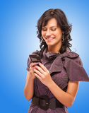 Charming girl reads sms on phone Royalty Free Stock Image