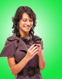 Charming girl reads sms on phone Stock Photo