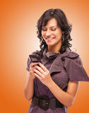 Charming girl reads sms on phone Royalty Free Stock Photos