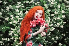 Charming girl with red hair stock images