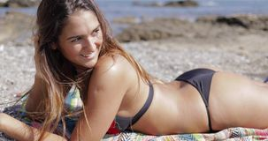 Charming girl relaxing on beach stock video