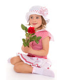 Charming girl with a rose in his hand. Stock Photo