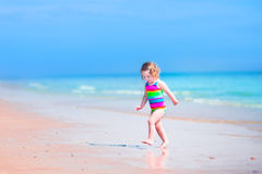 Charming girl running on a beach Royalty Free Stock Photos