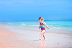 Charming girl running on a beach Royalty Free Stock Photos