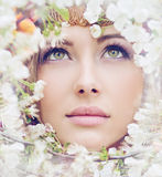 Charming girl's face among petals Stock Images