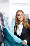The charming girl in shop Stock Images