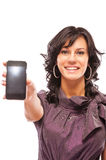 Charming girl stretches phone Royalty Free Stock Photo