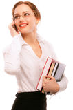 Charming girl-student speaks  by phone Royalty Free Stock Photography