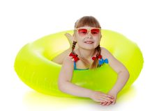 Charming girl in a swimsuit, sunglasses and yellow Royalty Free Stock Images
