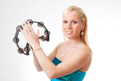Charming girl with tambourine. Charming blond girl with tambourine, isolated on white background stock photos