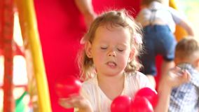 Little girl playing on a colorful Playground. stock video footage