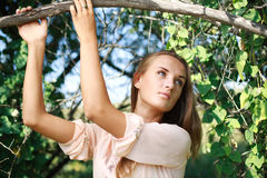 Charming girl to pose in summer garden Royalty Free Stock Images