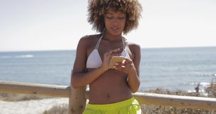 Charming girl using smartphone while training stock video footage