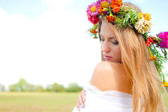 Charming girl wearing flower wreath and white Stock Photo