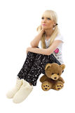 Charming girl wearing pajamas with teddy bear Royalty Free Stock Images