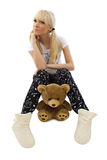 Charming girl wearing pajamas with teddy bear Stock Photo
