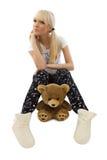 Charming girl wearing pajamas with teddy bear Stock Photo