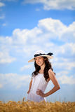 Charming girl in wheat field Royalty Free Stock Image