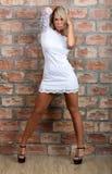 Charming girl white mini dress. Stock Image