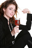 Charming girl with a wine glass Stock Images