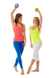 Charming girlfriends practiced aerobics in pair Royalty Free Stock Photos