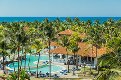 Charming, gorgeous amazing view of Cuban Cayo Guillermo island tropical resort with people in background on sunny warm day Royalty Free Stock Images