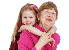 Charming granddaughter hugging beloved grandmother Stock Photography